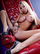 Red chair Busty blonde Kimber strips & fingers. Kimber James.